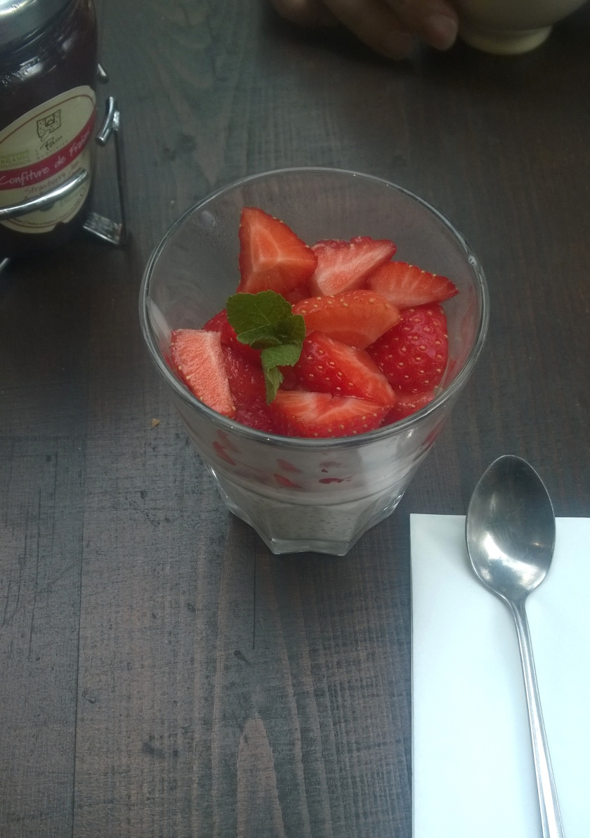 Chia pudding dessert with fresh strawberries at LPQ in Geneva