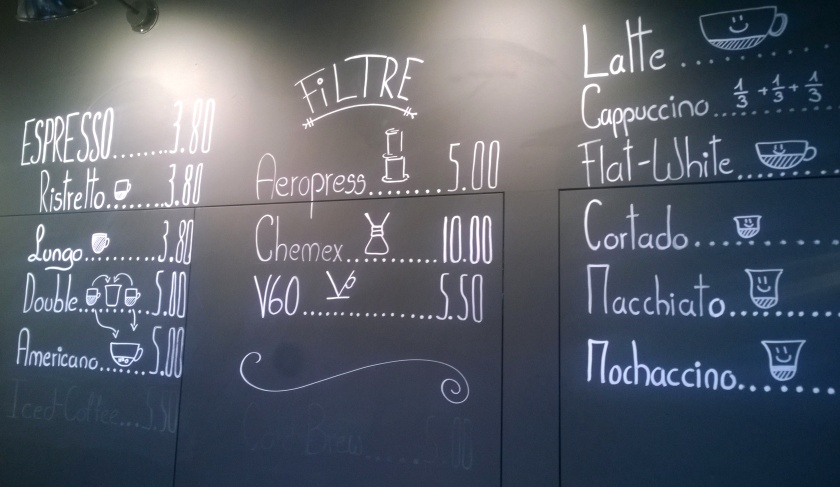 Blackboard with specialty coffees at Ex Machina