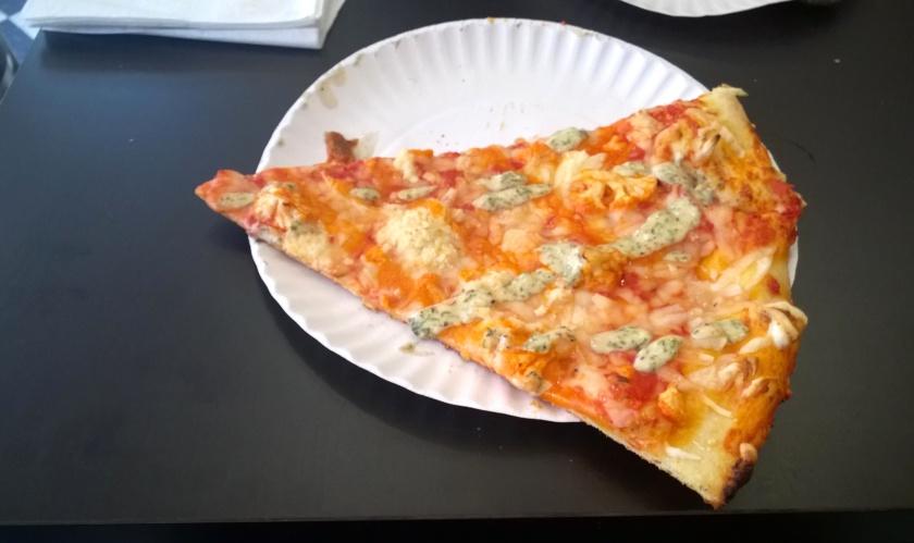 Slice of cauliflower pizza at Screamers PIzzeria